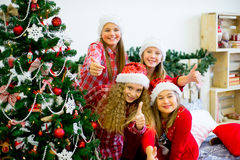 Girls decorate the Christmas tree Stock Photography
