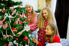 Girls decorate the Christmas tree Royalty Free Stock Image