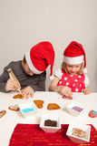 Girls decorating gingerbread cookies Royalty Free Stock Images