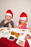 Girls decorating gingerbread cookies Stock Image