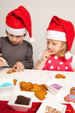 Girls decorating gingerbread cookies Stock Images