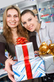 Girls delivering gifts Royalty Free Stock Photo