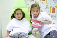 Girls at the dentist Royalty Free Stock Images