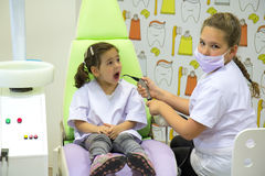 Girls at the dentist Stock Image