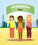 Girls of different nations stand holding hands and holding a friendship poster against stock illustration