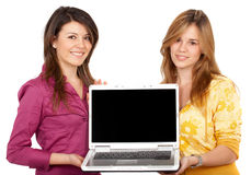 Girls displaying a laptop computer Royalty Free Stock Photography