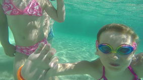Girls dive in the pool with his mother stock footage