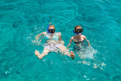 Girls with diving mask swimming in sea Stock Image
