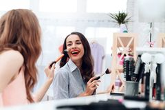 Free Girls Do Makeup In The Showroom. Two Beautiful Girls Have Fun And Smile. Royalty Free Stock Photo - 113835425