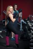Girls do weight-lifting exercises Stock Image