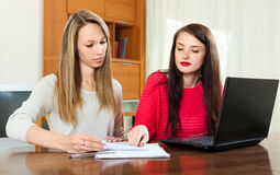 Girls with  documents and notebook Royalty Free Stock Photo