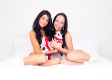 Girls with a dog Stock Photo