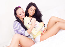 Girls with a dog Stock Photos