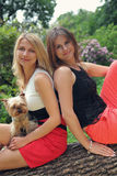 Girls with dog Stock Photo