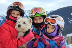 Girls with dog on the mountain Stock Photography