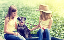 Girls with dog Royalty Free Stock Image