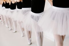 Girls doing ballet. Three young girls with gathered hair and black bodysuits stock photos