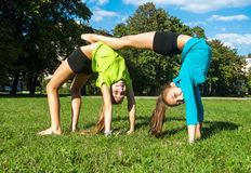 Girls doing the exercise outdoors Royalty Free Stock Photography