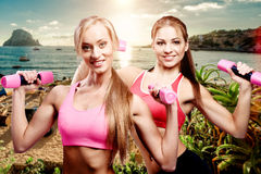 Girls doing fitness exercise with dumbbells Royalty Free Stock Photography