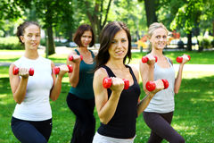 Girls doing fitness exercises Stock Photos