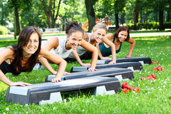 Girls doing fitness exercises Royalty Free Stock Photos