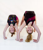 Girls Doing Gymnastic Poses Stock Images