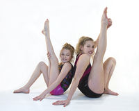 Girls Doing Gymnastic Poses Stock Photos