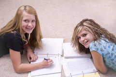 Girls doing homework Stock Images