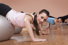 Girls doing pilates in a gym Stock Image