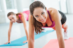 Girls doing push ups at the gym Royalty Free Stock Photography