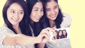 Girls doing selfie stock photography