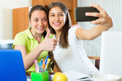 Girls doing selfie with smartphone at home Royalty Free Stock Photos
