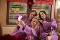 Girls doing Selfy on bachelorette party stock photos
