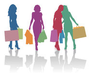 Girls doing shopping silhouettes. Detailed silhouettes of girls with shopping bags Royalty Free Stock Image