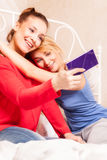 Girls doing themselves photo in a bedroom Royalty Free Stock Photo