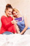Girls doing themselves photo in a bedroom Stock Image