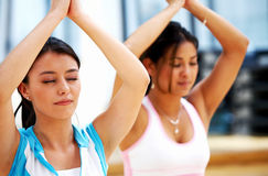 Girls doing yoga Stock Images