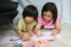 Girls drawing. Little girls doing art painting at home together Royalty Free Stock Images