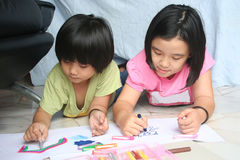 Girls drawing. Little girls doing art painting at home together Stock Photography