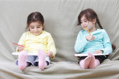 Girls drawing Royalty Free Stock Image