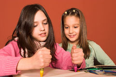 Girls drawing Royalty Free Stock Photo
