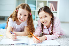 Girls drawing Stock Images