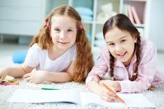 Girls drawing Stock Photo