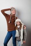 Girls dressed in knitted things Stock Photos