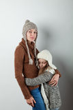 Girls dressed in knitted things Royalty Free Stock Photography