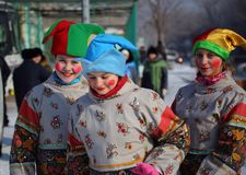 Girls dressed in traditional Russian clothes represent buffoons royalty free stock photo