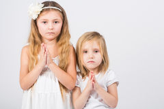 Girls dressed in white palms folded in prayer Stock Image