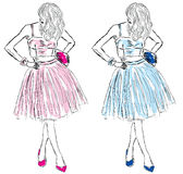 Girls in dresses of blue and pink fashion sketch Stock Photography