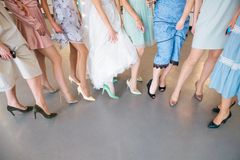 Girls in dresses party show feet selfie stock images