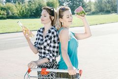 Girls drink alcohol at the supermarket. royalty free stock images